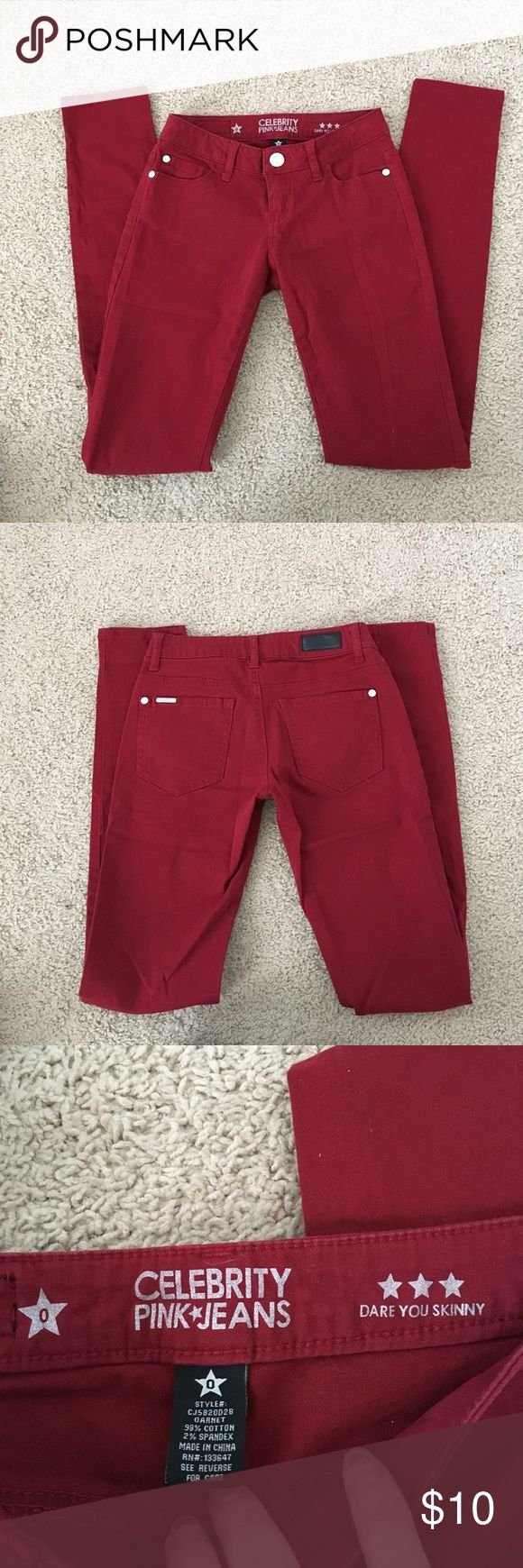 Red/maroon skinny jeans size0 Really pretty darker red skinny jean in good condition. Size 0 brand is celebrity pink Celebrity Pink Jeans Skinny