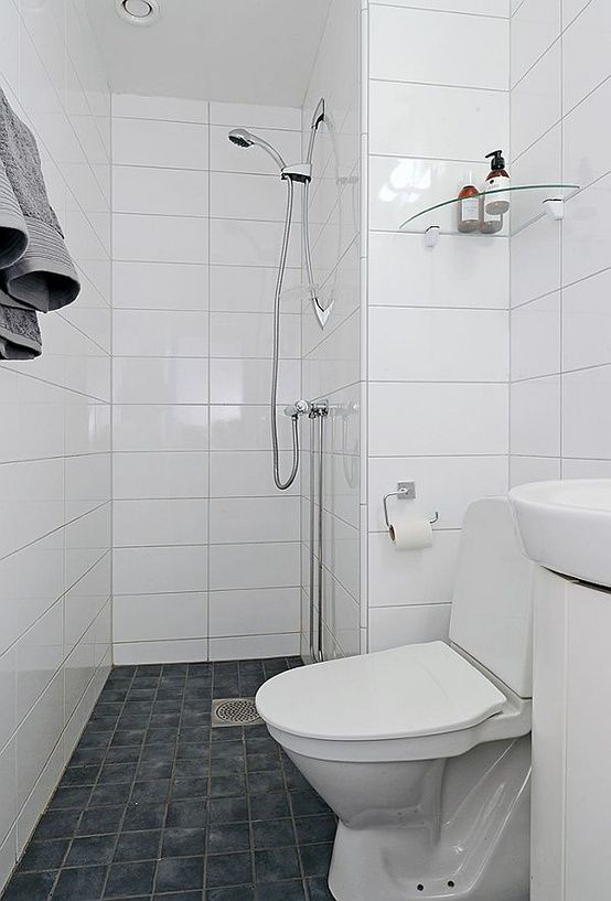 tiny bathroom – shower, toilet and sink Would definitely have a shower tray and curtain