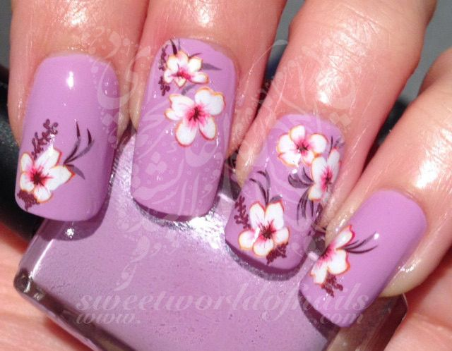20 water decals. Use: 1-Trim,clean then paint your nails with the color you want. 2- cut out the pattern and plunge it into water for 10 - 20 seconds. (use warm water in winter). 3- moisten the finger
