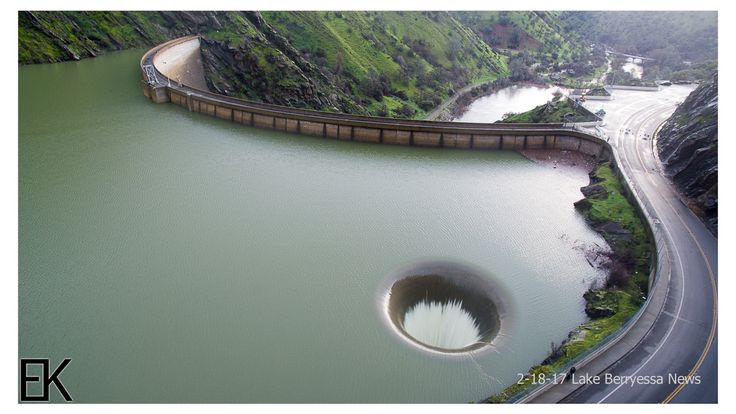 Drone Videos Capturing Water Overflowing Into Glory Hole Spillway at Lake Berryessa in Napa