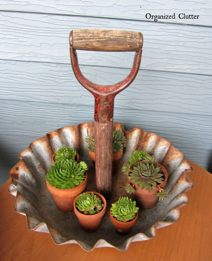 Organize odds-and-ends in this rustic shovel-handle display tray. Use it for little succulents, jewelry, or even cupcakes.  Get the tutorial at Organized Clutter.   - CountryLiving.com