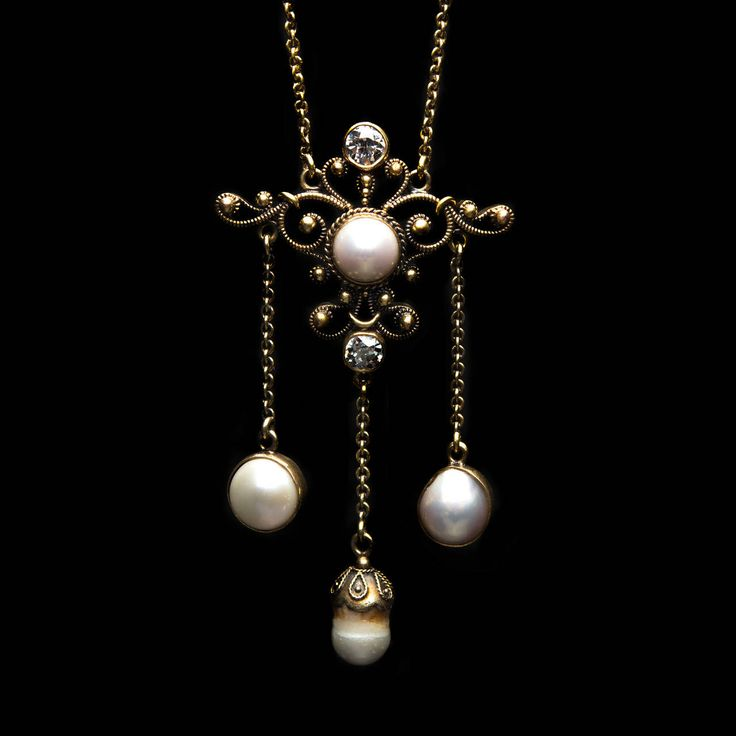 Mabe Pearl Diamond Gold Lavaliere Necklace. Lovely Lavaliere Necklace of Mabe Pearls and Diamonds Dating Back to the Early 20th Century. The two old mine cut diamonds have a total approximate weight of 0.26 carat. The pendant hangs from a delicate 16 inch chain.