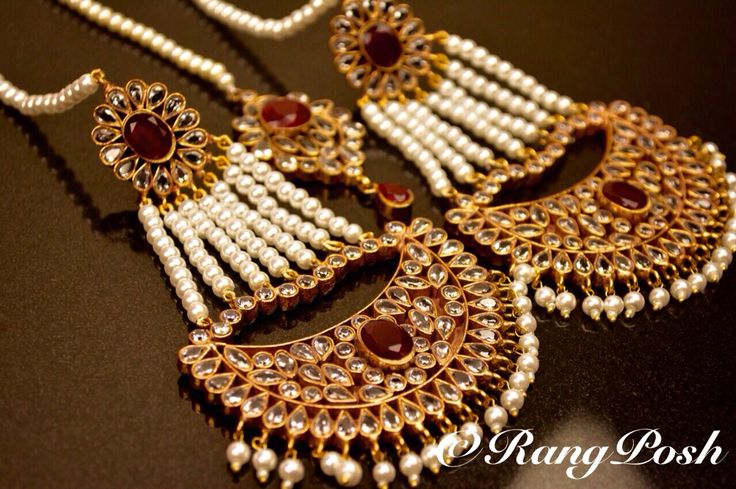 designer gold plated earrings and tikka set in semi precious stones.