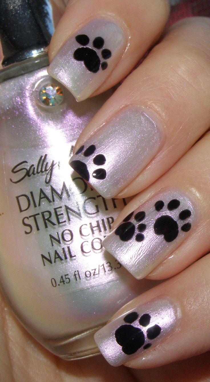 Paw prints nail art. Would look better with a different base color than silver
