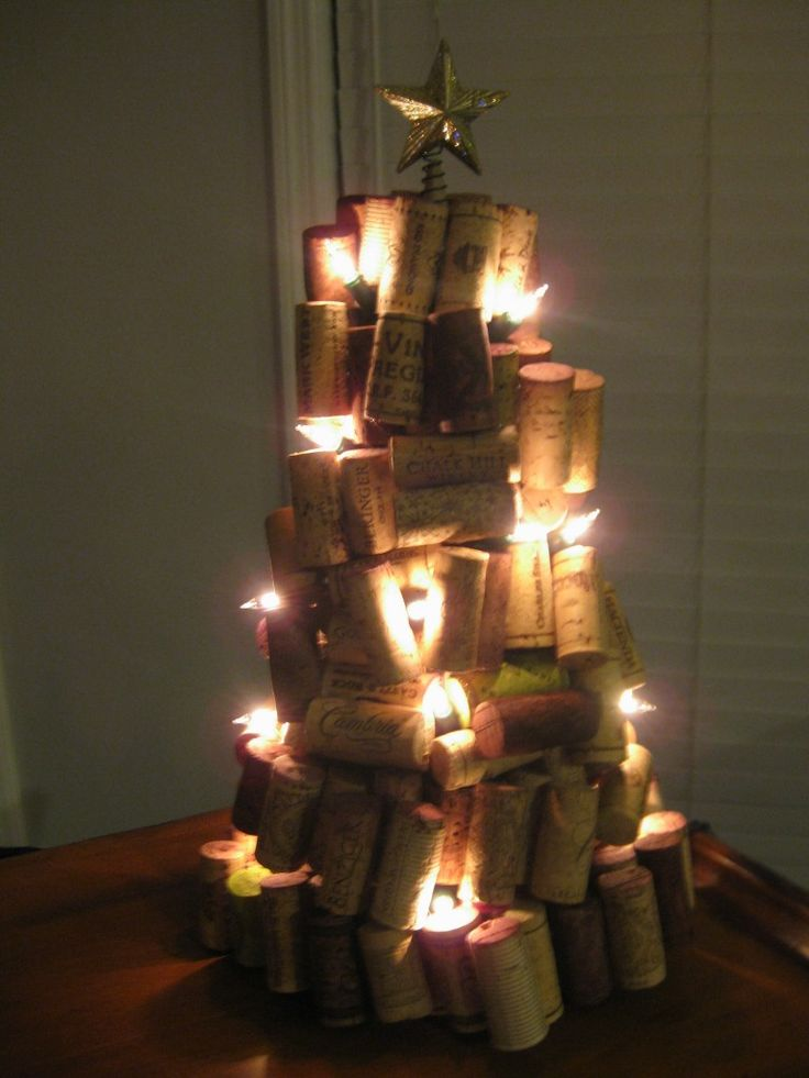 """And the cool thing about this... You can hang little ornaments off the corks by piercing the cork!  Idea: use old or """"single"""" earrings as decorations!  Oh I'm going to totally try this one!"""