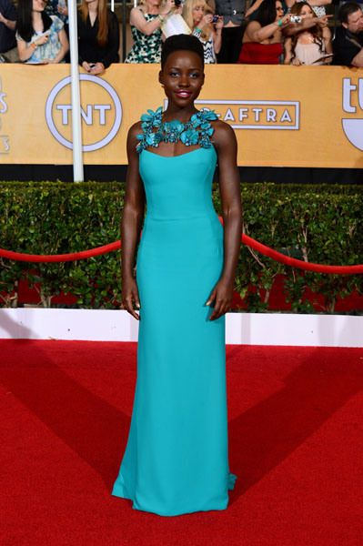 Lupita Nyong'o of '12 Years a Slave' knocked it out of the park in a turquoise blue gown accessorized with earrings by LoveGold.
