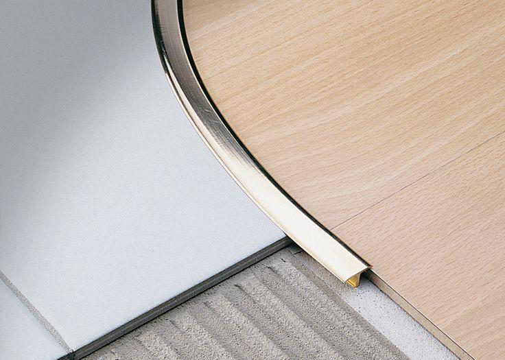 Joint de dilatation entre carrelage et parquet en bois, acceptant forme courbe. modèle Covertec SP marque Profilitec