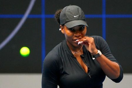 Serena Williams of the US bites her finger during a training session ahead of the Australian Open tennis tournament in Melbourne, Australia