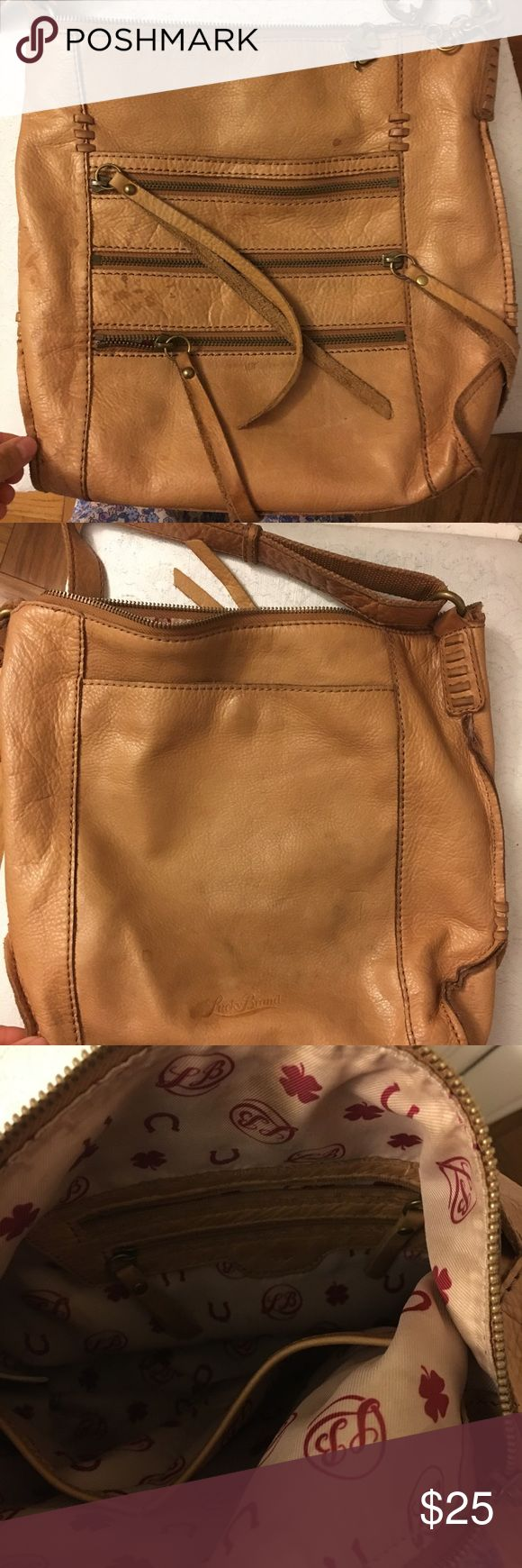 Lucky brand purse Upper cute and spacious lucky brand purse still in pretty good condition does have stains as pictured. Adjustable strap. Lucky Brand Bags Crossbody Bags