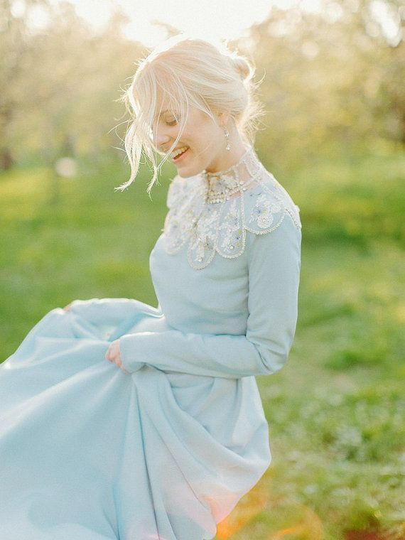 Blue wedding dress in a pre-Victorian bridal gown homage.  Very nice.  Doesn't she look happy too?  And blue.  Poet, didn't know it