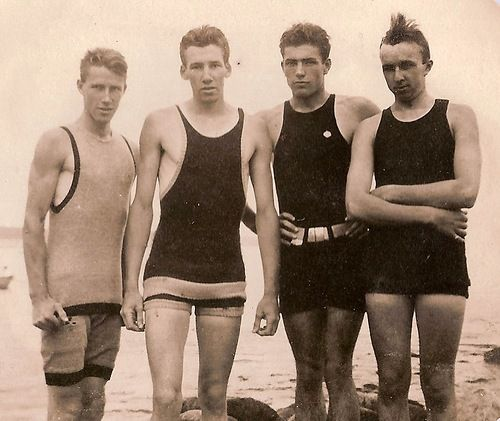 The Boys of Summer 1910 edition. SWIM WEAR. Spiked hair would not be in fashion. Just mussed up. [Man on right]