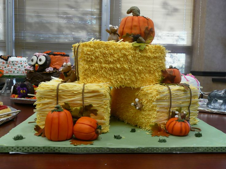 "Not so spooky, but fun for Halloween.  Everything is edible.  The mice and pumpkins are made out of fondant/gumpaste.  The hay bales are decorated with buttercream and rice paper for added straw effect.  The cake was  equally as delicous with one bay of Pumpkin spice, one of Devil""s food and one of French vanilla."