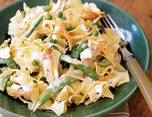 Comforting and colorful with carrots, sugar snap peas and a creamy, brothy sauce, this chicken dish is ideal for leftover rotisserie chicken. Recipe: Chicken with Lemony Egg Noodles and Peas   - Delish.com
