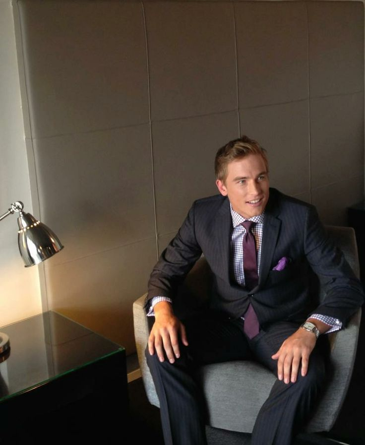 Bernie Vince being photographed at the hotel for Peter Jackson Menswear.