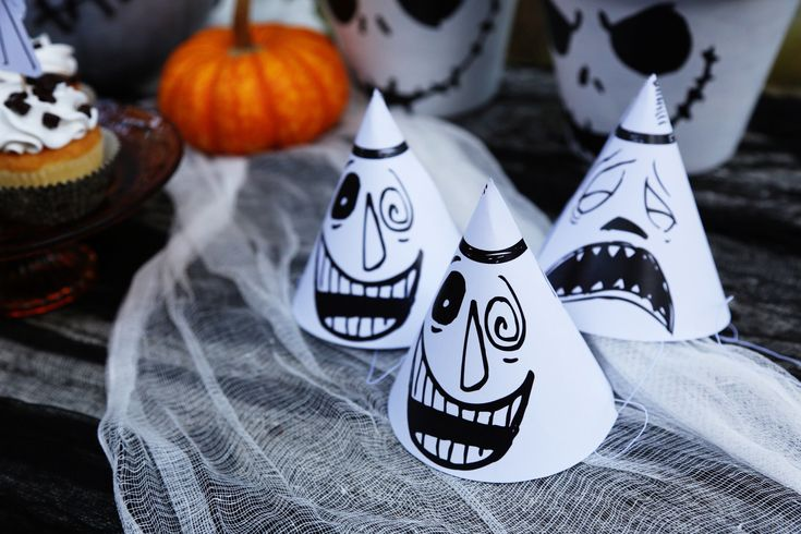 Thanks to HP® for sponsoring this article. Inspired by the many faces of the Mayor from Tim Burton's The Nightmare Before Christmas, you can print and assemble these party hats for your guests!