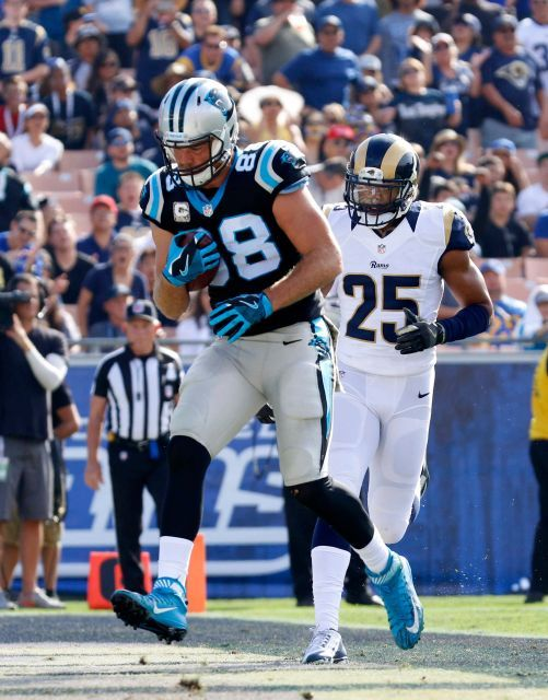 Panthers vs. Rams:  13-10, Panthers  -     Carolina Panthers tight end Greg Olsen, left, runs past Los Angeles Rams strong safety T.J. McDonald for a touchdown during the first half of an NFL football game, Sunday, Nov. 6, 2016, in Los Angeles.