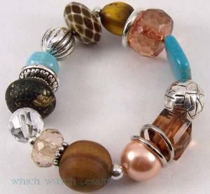 Made with brown, peach, bronze, black, yellow & turquoise colored beads! As well as silver plated beads!