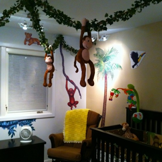 Jungle theme nursery. Love the hanging monkeys! Pinned for BabyBump, the #1 mobile pregnancy tracker with the built-in community for support and sharing.