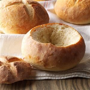 Quick and Easy Bread Bowls Recipe -Impress all of your friends by serving cream soups or dips in bread bowls. It's one of the most popular recipes on my blog, yammiesnoshery.com.
