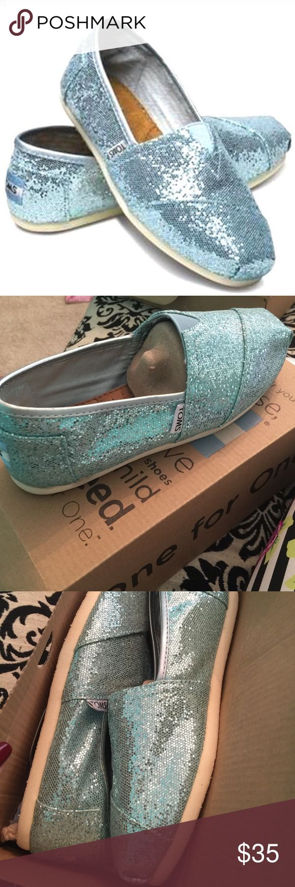Brand New sparkly blue toms Brand new sparkly blue toms come in original box. TOMS Shoes Flats & Loafers