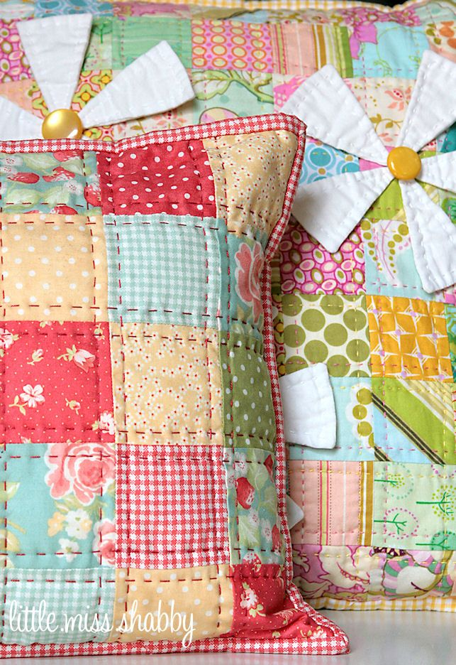 I love the hand quilting on the pillow but also love the 3D flowers on the background quilt.  Little Miss Shabby does it again!