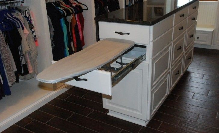 Furniture, Large Walk In Closet Idea With Full White Stoage Design And Island With Drawers And Ironing Board Storage Cabinet Upon Black Tile Flooring Idea ~ Ironing Board Storage Cabinet: a Simple Solution to Minimize the Messy Look of Your Laundry Room