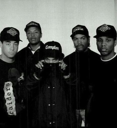 N.W.A (Niggaz Wit Attitudes), former rap group Arabian Prince (not shown), DJ Yella, Dr. Dre, Eazy-E, Ice Cube, & MC Ren) & one of the seminal acts of the Gangsta rap music. Considered controversial due to their explicit lyrics, they were banned from many US radio stations. In spite of this, they have sold over 10M units. Their album Straight Outta Compton marked the beginning of the new gangsta rap era as the production and social commentary in their lyrics were revolutionary in the genre.