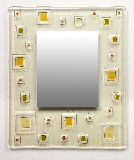 "Fused glass mirror made of translucent glass and colored design elements. Inside mirror measures 10.25""H x 6.25""W."