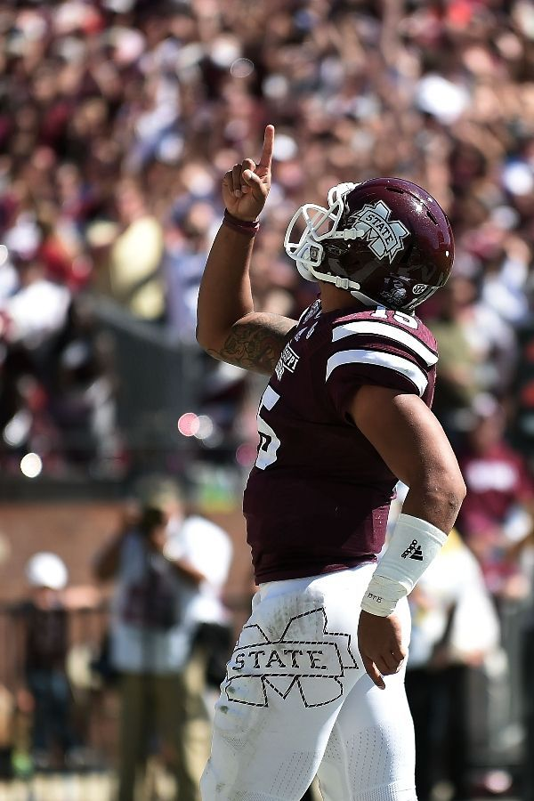 Mississippi State Football - Bulldogs Photos - ESPN-STARKVILLE, MS - OCTOBER 04: Dak Prescott #15 of the Mississippi State Bulldogs reacts to a touchdown during the third quarter of a game against the Texas A&M Aggies at Davis Wade Stadium on October 4, 2014 in Starkville, Mississippi. Mississippi State won the game 48-31. (Photo by Stacy Revere/Getty Images)