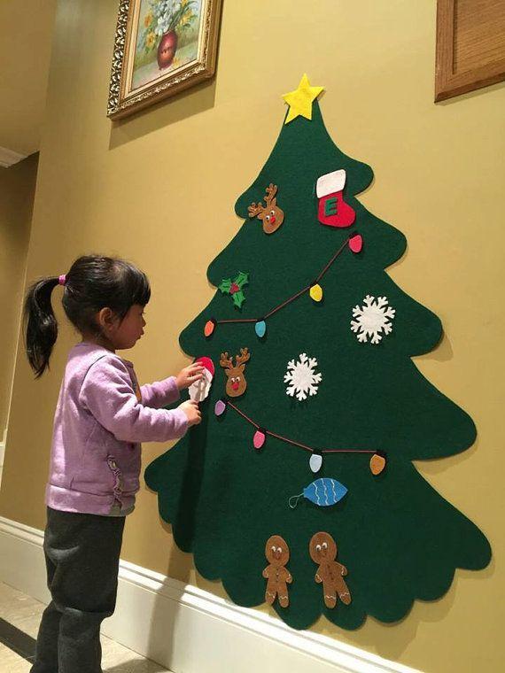 M s de 25 ideas fant sticas sobre coronas para puerta en for Arbol de navidad mural
