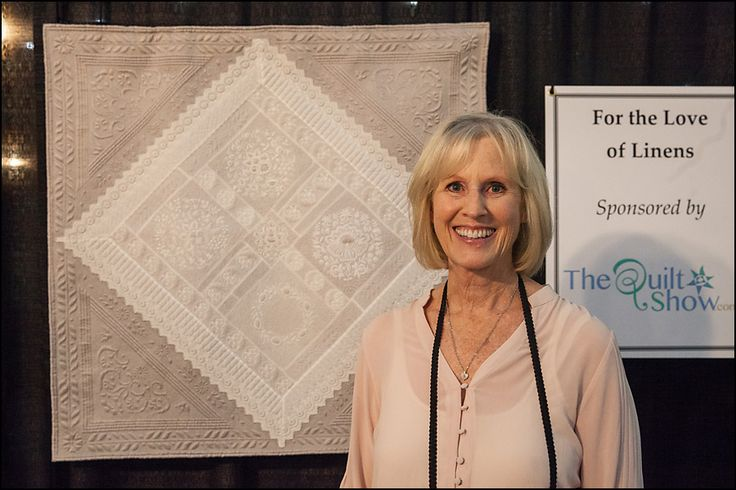 """This is Karen Azevedo with her French bonnets piece...absolutely exquisite.  Karen was my """"long arm"""" Linen Lady and had five beautiful pieces in the exhibit.  She was another huge part of the exhibit and was there nearly 100% of the time teaching and talking to everyone.  Couldn't have done it without her!"""