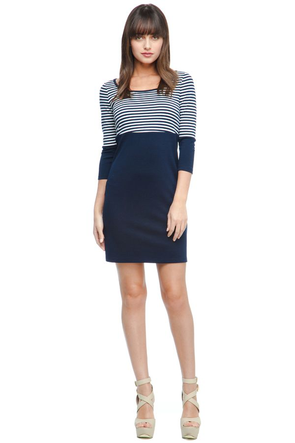 This nautical bodycon dress looks great with nude pumps and a long pendant necklace!