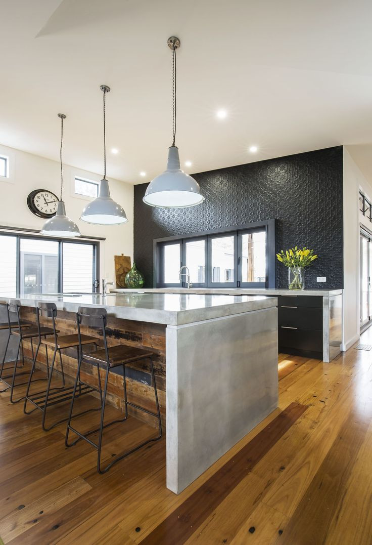 Industrial Kitchen with an eclectic twist. Featuring concrete benchtops, pressed metal splashback, Black Satin & Axolotl copper faced doors and reclaimed timber paneling. Credit: Craigs_Workshop for many of the industrial elements. #DanKitchensAus