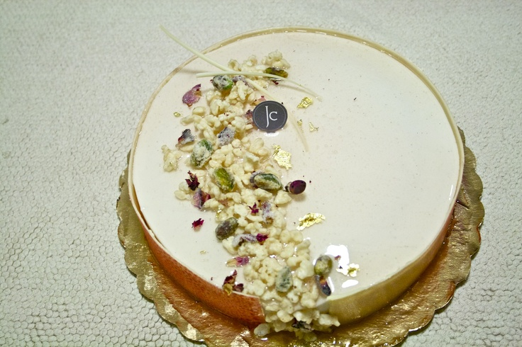 """Kheer Royale"" Modern take on an Indian rice pudding flavored cake - Vanilla chiffon, rose petal jam, pistachio crèmeux, cardamom mousse topped with pistachio dragée, candied rose petals, and white chocolate covered puff rice"
