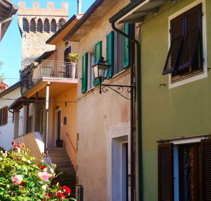 Brunelleschi's Medieval tower peeps between the village houses
