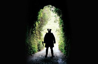 Man standing in a tunnel