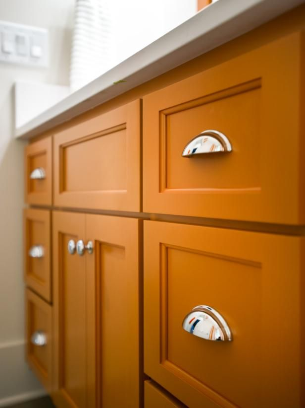 Would you dare to paint your cabinets pumpkin spice orange? See this room on HGTV.com. (http://photos.hgtv.com/photo/contemporary-white-and-burnt-orange-vanity?soc=Pinterest)