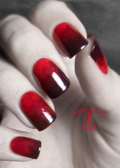 Red nails with just enough spook for Halloween! Pretty nails. Thejavawitch