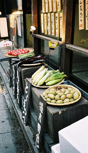 Japanese vegetables in front of a restaurant, showing the fresh fare...