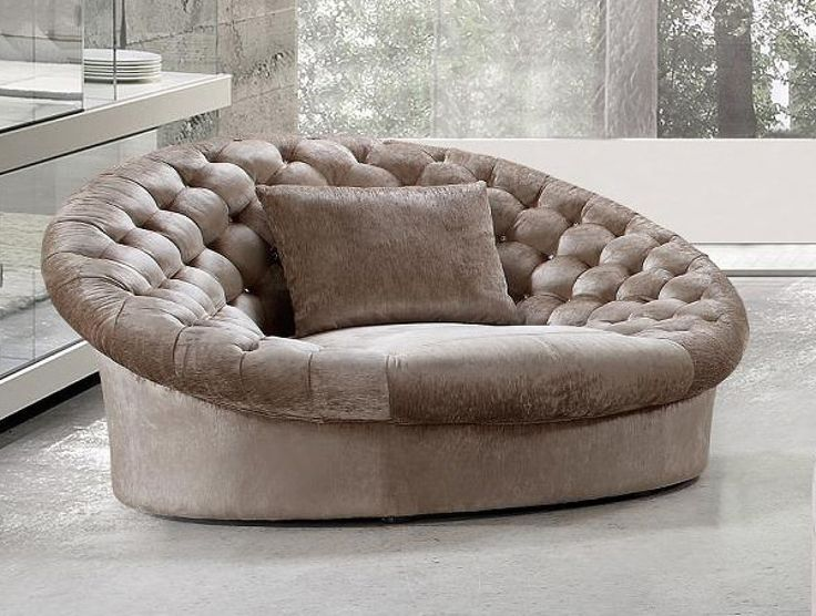 Sit back and relax on the glamorous Cosmopolitan Sofa Chair. Upholstered in a soft beige velour fabric with quilted crystal tufted backing. The rounded edges and gradual curve of the sofa chair create