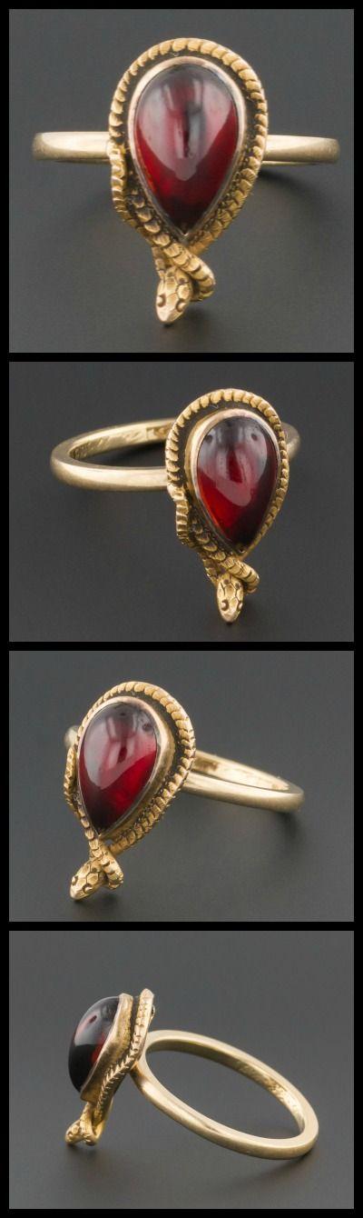 This garnet and gold snake ring was originally  an antique stickpin (circa 1890-1910). At Trademark Antiques.