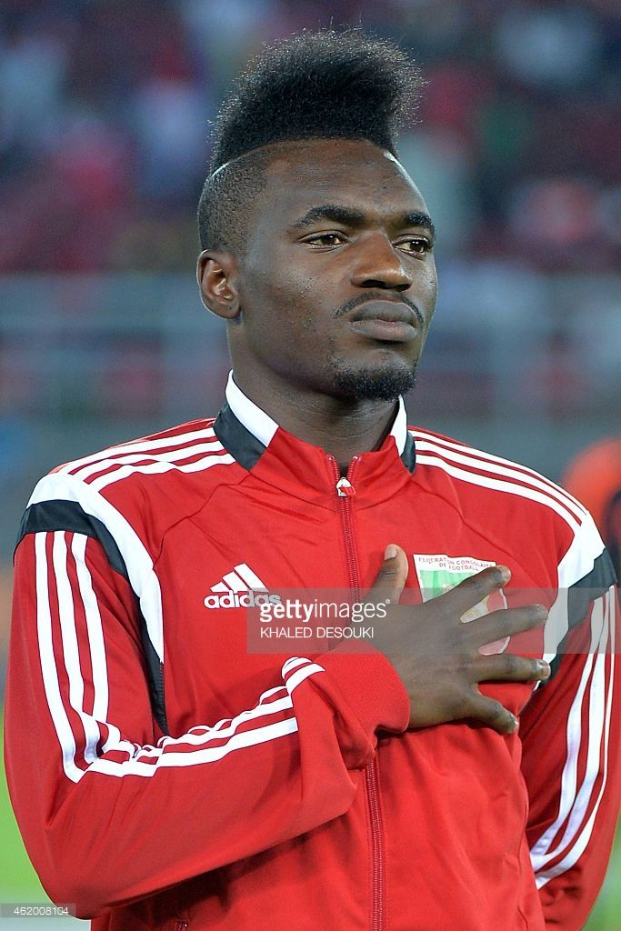 congos-forward-thierry-bifouma-listens-to-his-national-anthem-ahead-picture-id462008104 (683×1024)