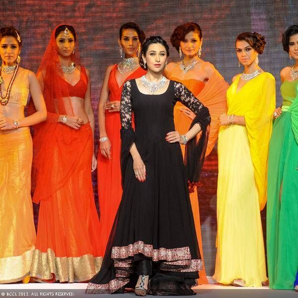 Karisma Kapur poses with the models during Kays Jewels show during the India International Jewellery Week (IIJW), held at Grand Hyatt, Mumbai, on August 07, 2013.