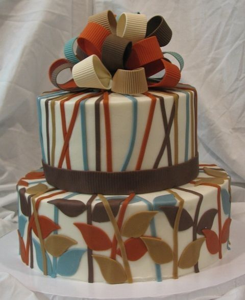 Yes, this is actually a cake I did for a baby shower. It was made to match the baby bedding. The cake is done in buttercream with fondant accents. The bow is done in gumpaste.