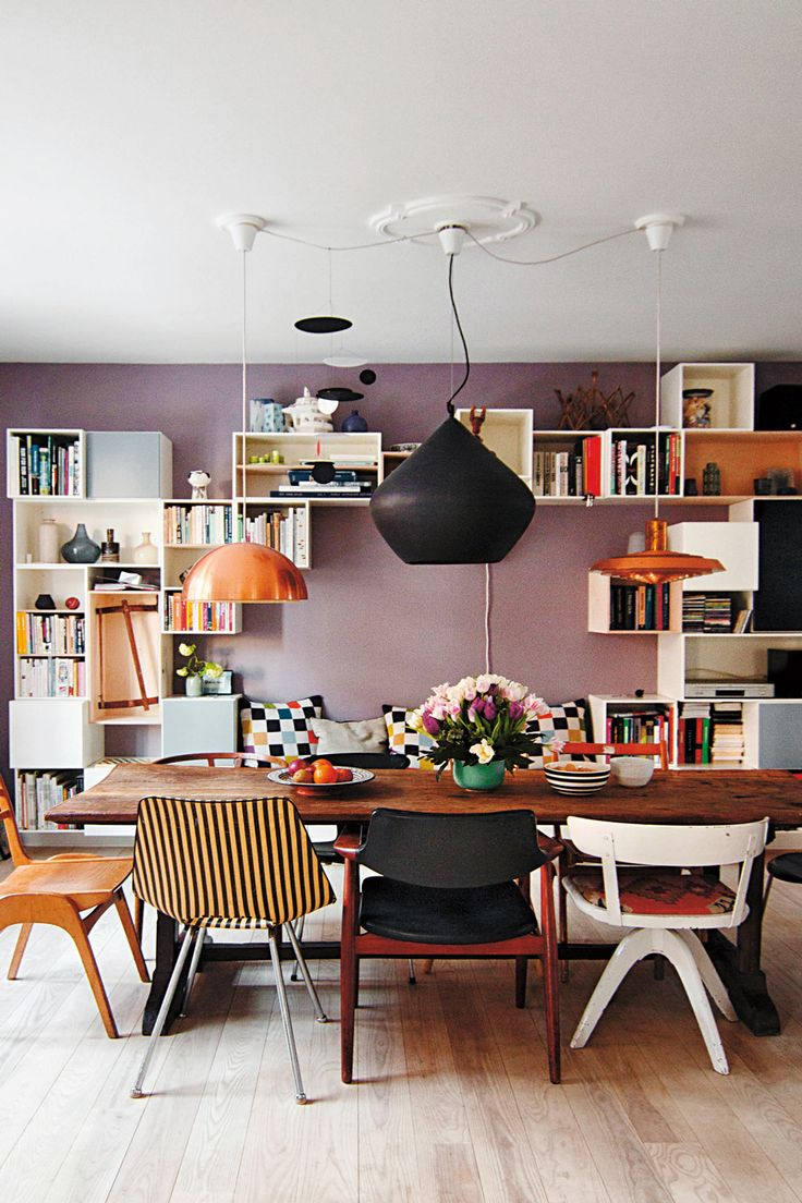 Lovely home in Copenhagen. Proof that three lights are better than one... Love the mauve, lavender wall, mismatched chairs, and smart modular storage.