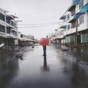 A survivor of the tsunami wanders the streets of Banda Aceh, Indonesia, January 2005