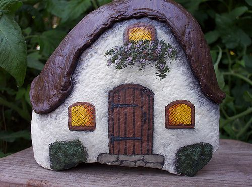 HAND PAINTED ROCK Thatched Roof Cottage by WytcheHazel on Flickr I created a roof line on this large cottage with wood putty.
