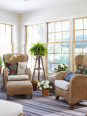 Pottery Barn's sea-grass armchairs blend interior comfort with outdoorsy charm in this sunroom. #decorating