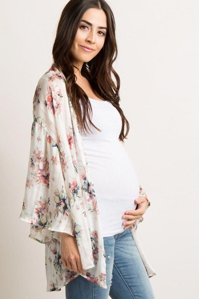 21bf4631e5 A floral print chiffon peplum maternity kimono. Long bell sleeves. Open  front. This style was created to be worn before