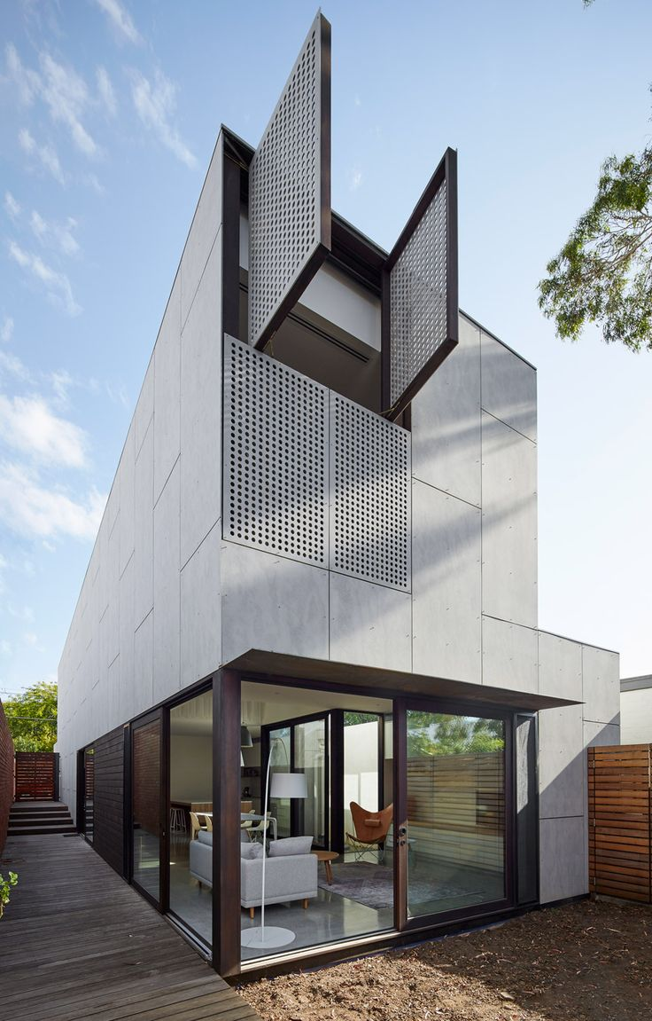 House Cladded With Cement Panels And Perforated Shutters